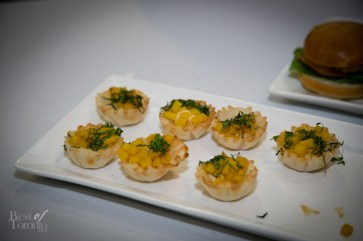 Phyllo cup, minted chickpeas and saffron potato crisp basil toast, brie cheese and oven-dried tomato and apple jam by Destingo