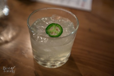 Coco Peno rum cocktail with coconut, ginger syrup topped with a slice of jalapeno