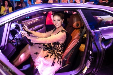 Ainsley Kerr modelling the Cadillac ELR in her Narces dress