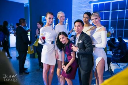 Guests posing with the models