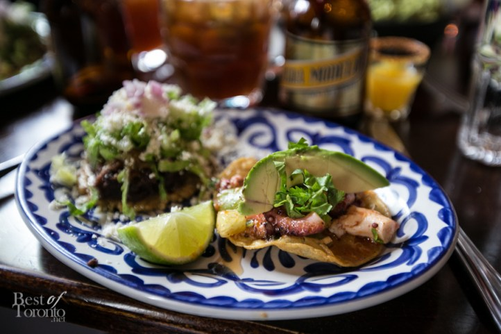 """""""Tostadita De Pulpo"""" with crisp corn tortillas, tender octopus marined in lime with tomatillo and chipotle chilies en adobo. To the left is the braised pork carnita """"Sope Plazero"""""""