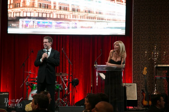 Auctioneer, Jay Mandarino on stage with Carla Collins