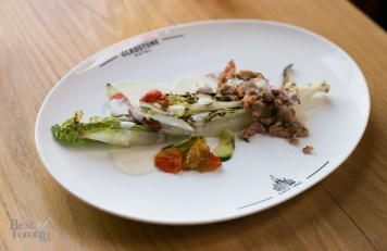 """Blue Crab Salad"" with fennel-roasted tomatoes, coconut lime dressing on a charred romaine heart"