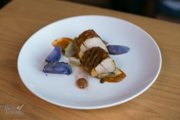 """""""Vindaloo Pork"""" with local pork tenderloin, brown butter confit grapes, """"new"""" potatoes, endive and vindaloo sauce. One of my favourite dishes on this Gladstone Hotel menu."""