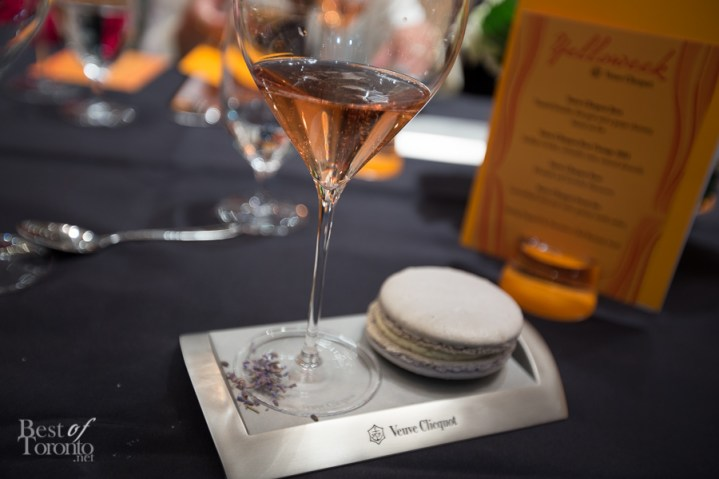 An absolutely delectable and large lavender macaron with rhubarb filling paired with Veuve Clicquot Rose
