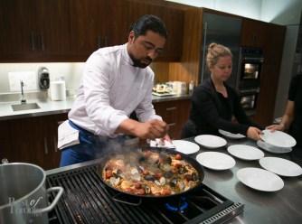 Chef Luis Valenzuela (Carmen) making Spanish paella with seafood