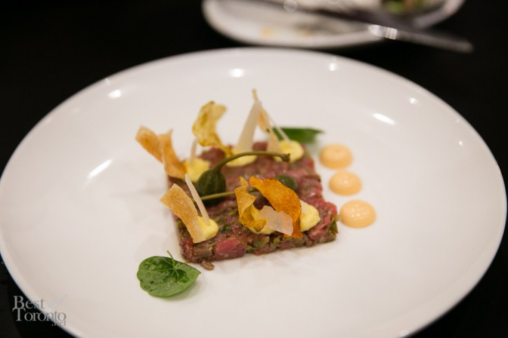 Steak tartare with hand cut beef tenderloin, potato crisps, deviled egg, capers, parmigiano