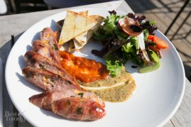 Jalapeno cheddar sausage dish with spiced ketchup, house-made mustard, grilled naan bread