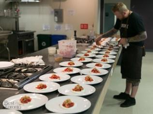 Chef Derek Dammann preparing dessert: Strawberry Poached Rhubarb, Vanilla Cremeux & Pie Crust Crumble
