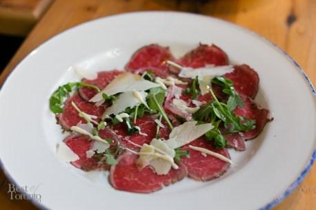 """""""CARPACCIO DI MANZO"""" with beef tenderloin crudo, brandy crema, pickled onions, grana padano, arugula"""