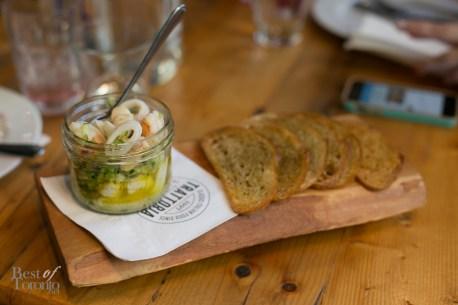 """""""FRUTTI DI MARE"""" with marinated shrimp, bay scallops, calamari, red onion, crostini"""