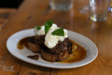 """SHORT RIB CROSTINI"" - sticky beef short ribs, fior di latte, grilled sourdough, basil ."