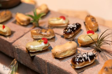 Assorted Eclairs (Pistachio Cherry, Banana Nutella, Coffee 7 Cocoa Nibs, Vanilla ORange, Dulce de Leche, Pumpkin Pie) by The Tempered Room