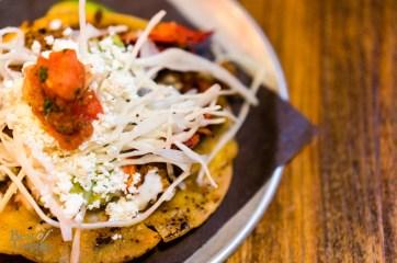 Langosta crispy taco: lobster sauteed in an arbol mantequilla   Photo: John Tan