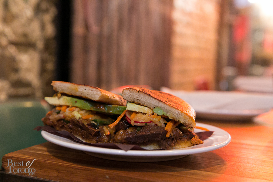 Torta Coreana with grilled kalbi beef and braised short rib, avocado, house kimchi, pickled pear and escabeche | Photo: Nick Lee