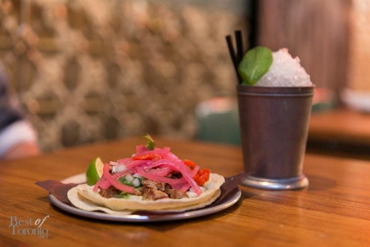 Carnitas de Maciza with pork shoulder confit, tomatillo salsa, pickled onion, charred habanero   Photo: Nick Lee