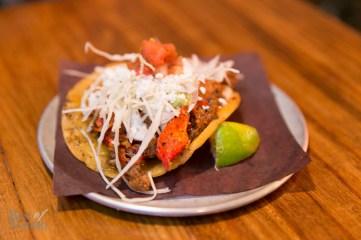 Langosta crispy taco: lobster sauteed in an arbol mantequilla   Photo: Nick Lee