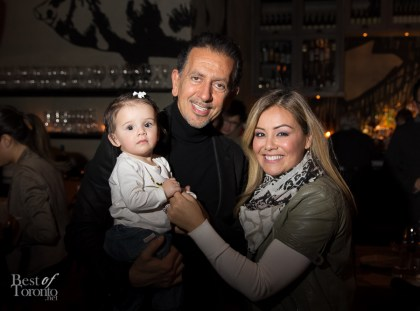 Charles Khabouth saying hello to Melissa Grelo's new baby daughter