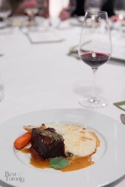 Braised beef short rib with artisanal grits, pumpkin seed gremolata. Paired with 2012 Santa Barbara Winery Syrah from Santa Ynez Valley (5oz)