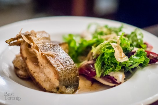 Trout steak, brown butter and honey vinaigrette, charred bitter leaves