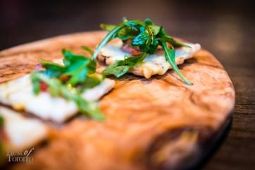 Charcuterie, cheese and arugula tart