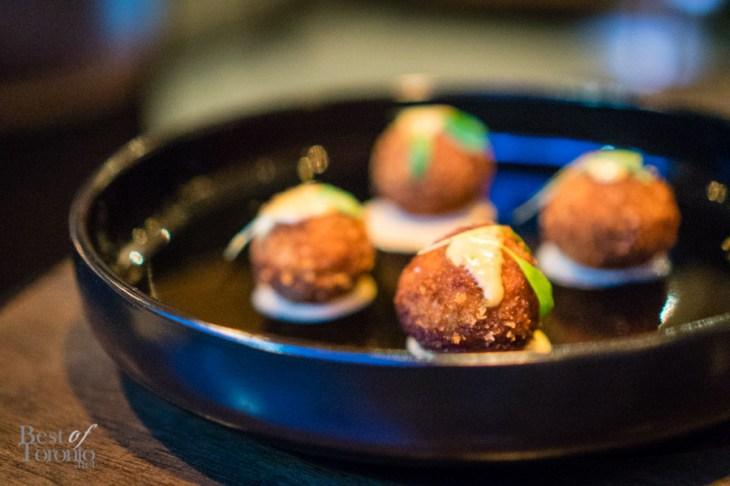 Porcini arancini with truffle aioli and parmigiano