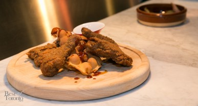 """""""General Sanders' Chicken"""" with kung pao sauce, sichuan maple syrup, HK egg waffles"""