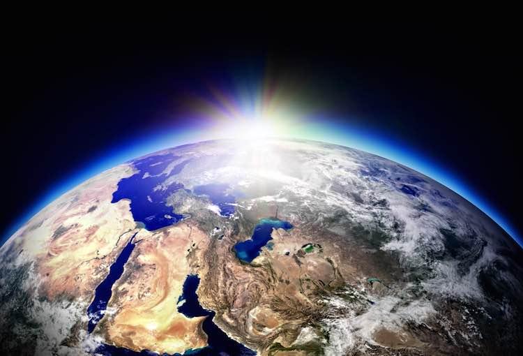 Sun rising over planet Earth