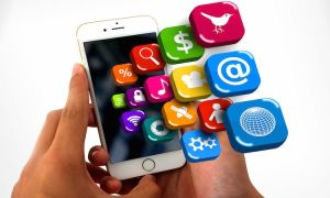 Smartphone on hands with app icons