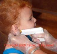Violet getting her ears pierced