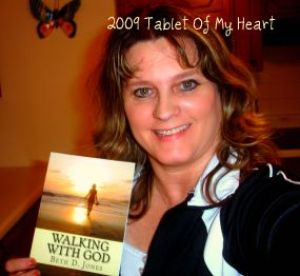 Me with my first book, Walking with God