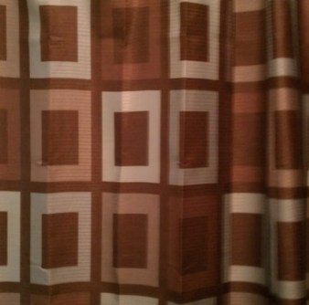 Chocolate brown-teal curtain and brown rug