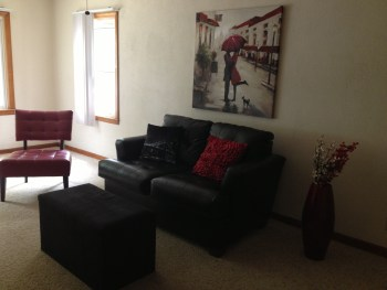 Red chair and loveseat