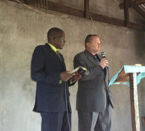 Ray Jones, speaking, Bungoma, Kenya Pastor Patrick interpreting