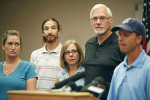 Jennifer's tearful, frightened parents (woman with glasses and man with white beard and glasses), and Jennifer's husband Callan in cap at press conference