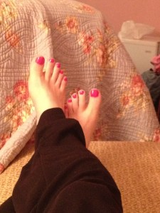 my painted toenails, relaxing in the chair
