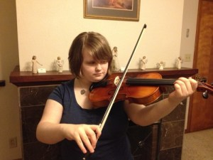 Our daughter Leah with her violin