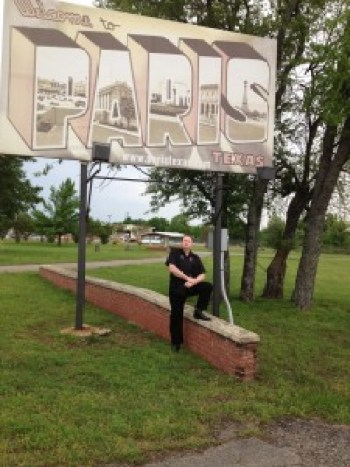 Ray in front of Paris, TX sign