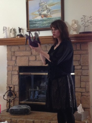 Me speaking at Olathe Aglow with shoes visual aid