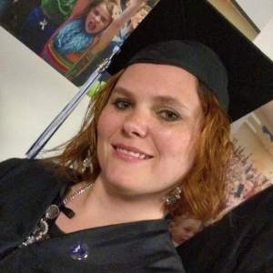 Heather in her cap, tassel, and gown