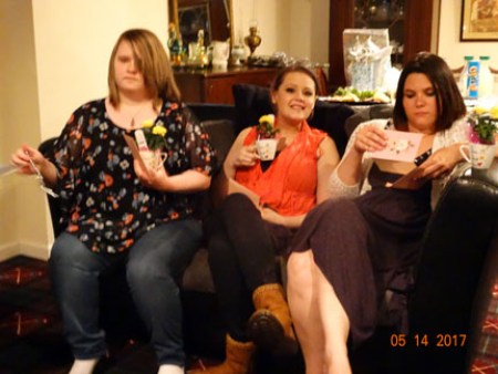 Our 3 beautiful daughters with their yellow roses in the teacup I gave them