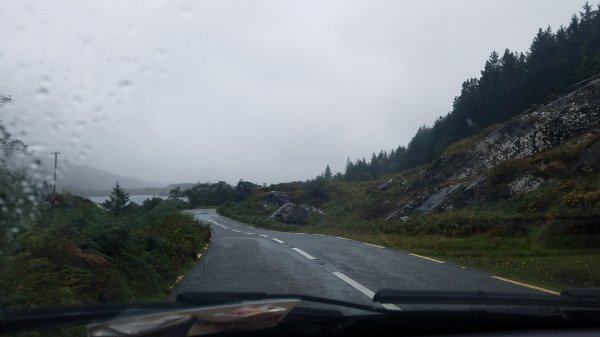 Light rain on windshield in mountains