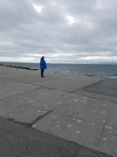 Me looking at Atlantic Ocean in my raincoat