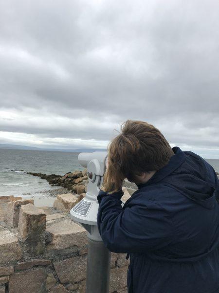 Leah looking through telescope