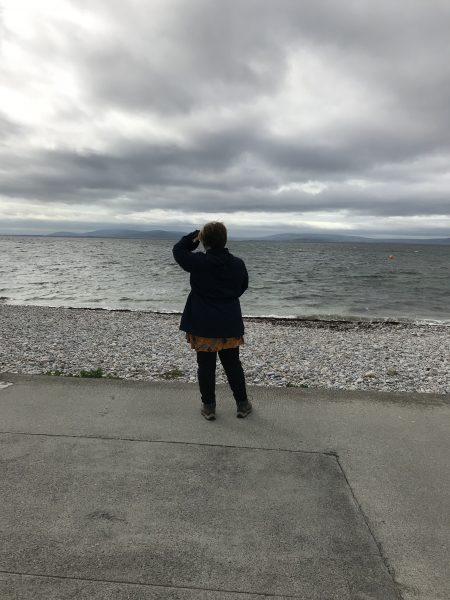 Leah looking at the ocean on Salthill Promenade