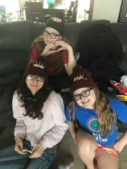 Beautiful girls! Our granddaughters Violet and Annabelle and their friend Kelsey in their Valentine's Day beanies I bought them. So cute!