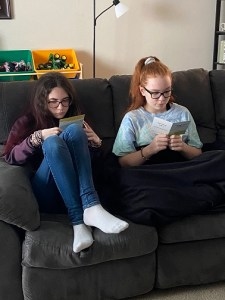 Annabelle and Violet reading their cards