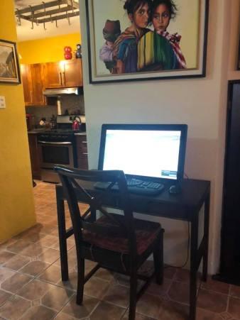 Kim's desk and laptop