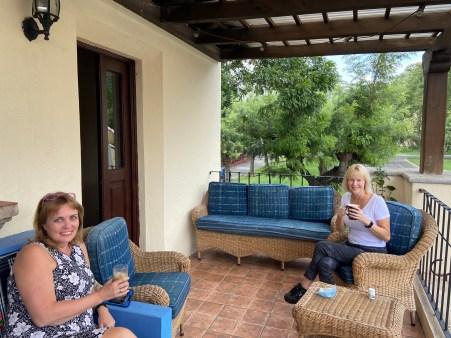 Kim & her friend Jennifer on terrace, having coffee