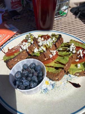 toast with avocado and feta cheese, and blueberries
